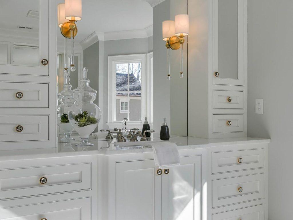 Large white vanity with quartz countertop