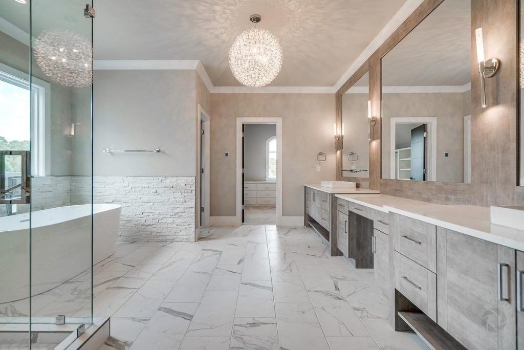 Modern master bathroom with quartzite vanity countertop and porcelain tile