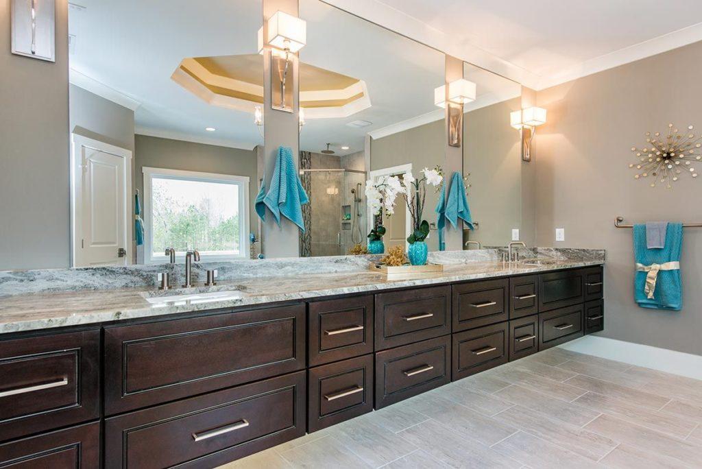 Dark wooden stretched vanity with granite countertop