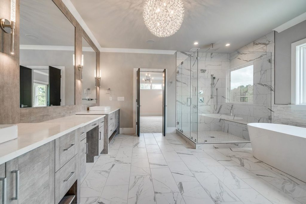 Large master bathroom with quartzite vanity countertop and porcelain tile