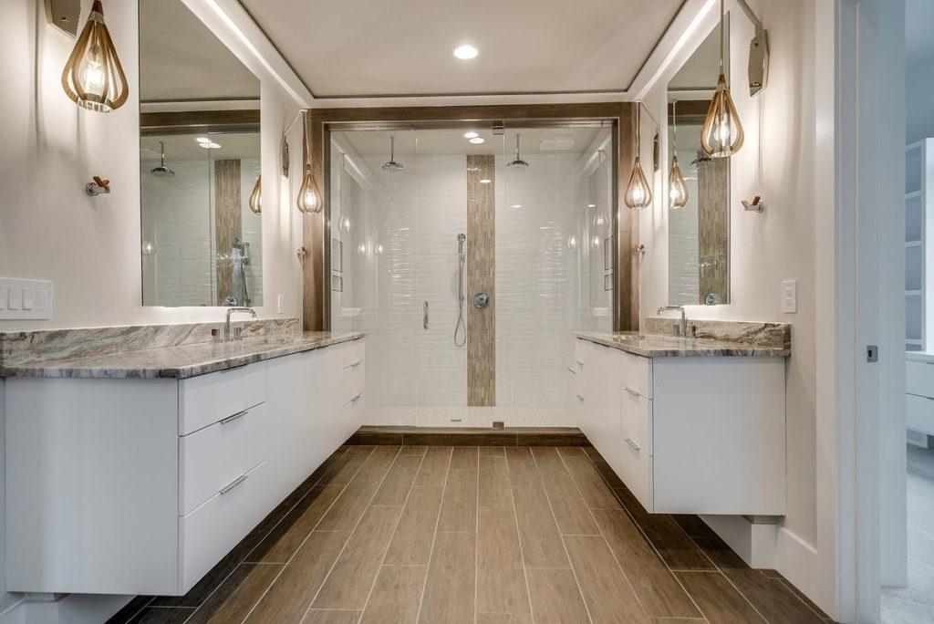 Duel quartz vanities with walk in porcelain tile shower