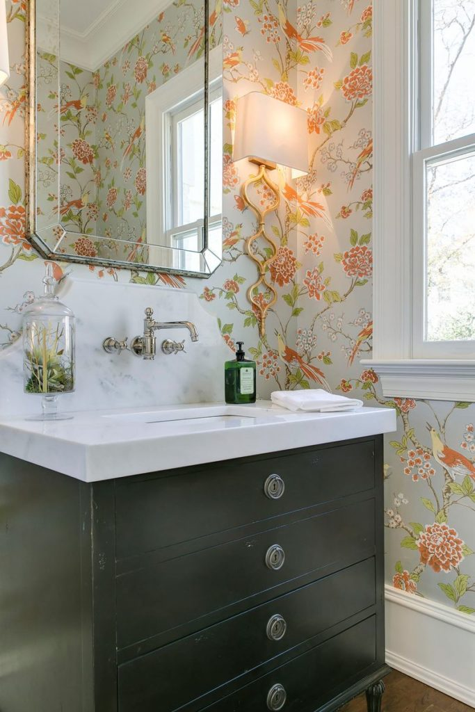 Elegant art deco vanity with marble countertop and silver hardware