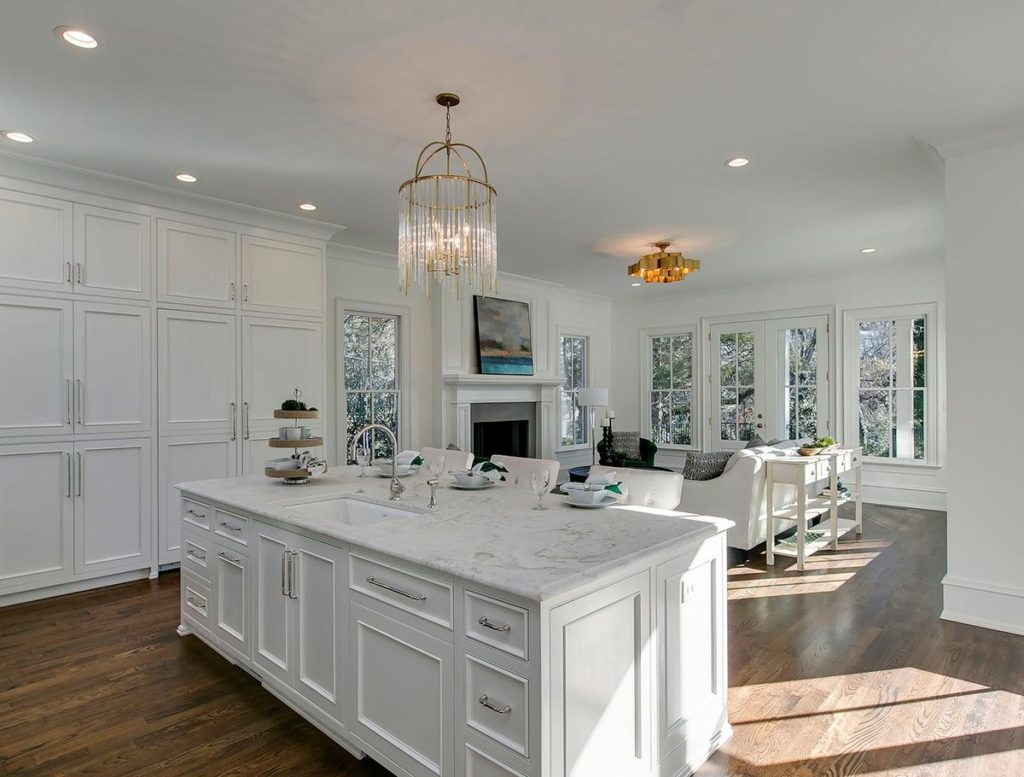 Stunning white kitchen cabinets and island with white granite countertop