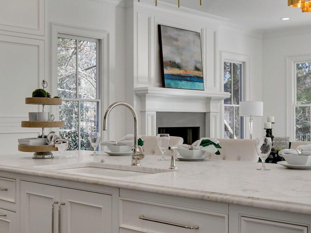 White kitchen with silver hardware and white granite countertop