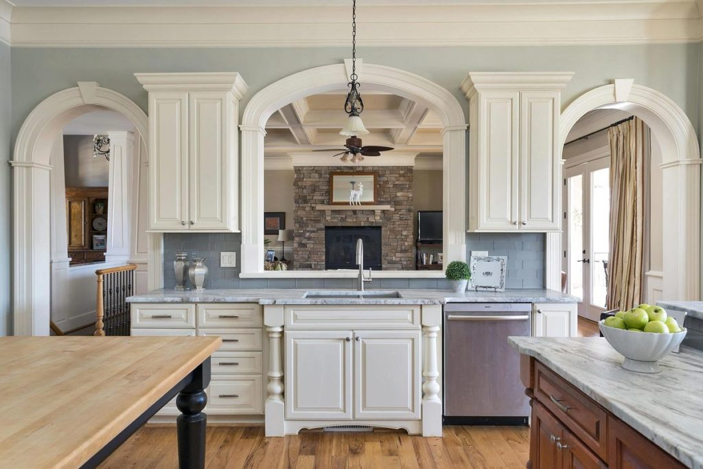 Craftsman style white built-in cabinets with silver blue granite countertop