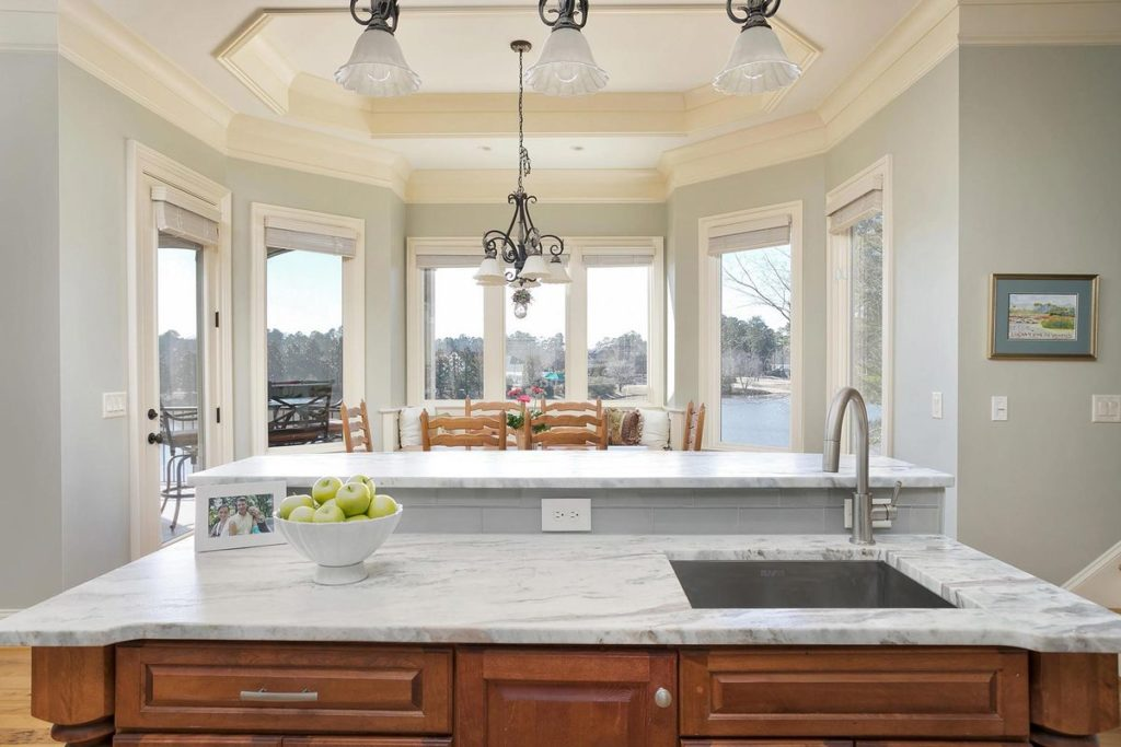 Kitchen island with bar seating and silver blue granite countertop