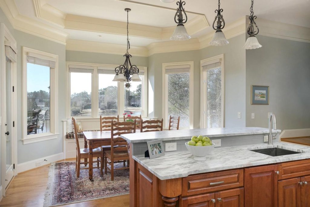Craftsman style kitchen island with silver blue granite countertop