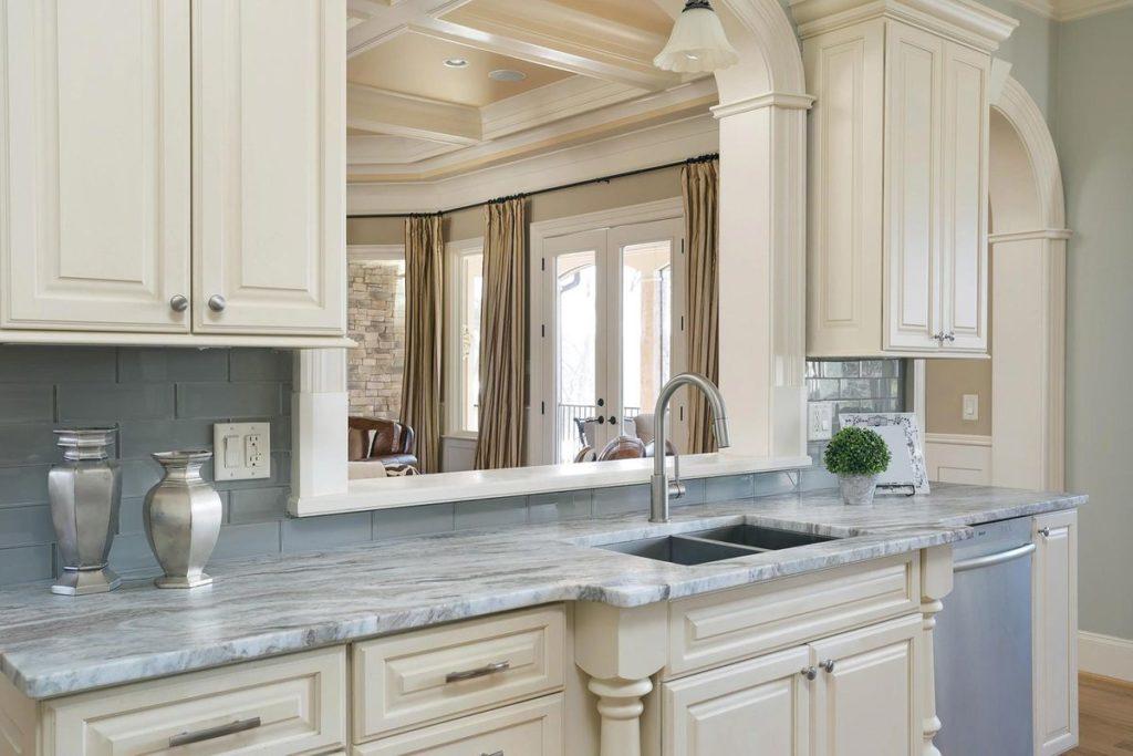 Farmhouse sink with silver blue granite countertop surround