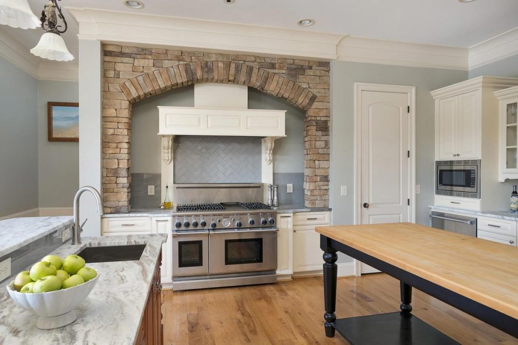 Farmhouse kitchen with white cabinets and silver blue granite countertops