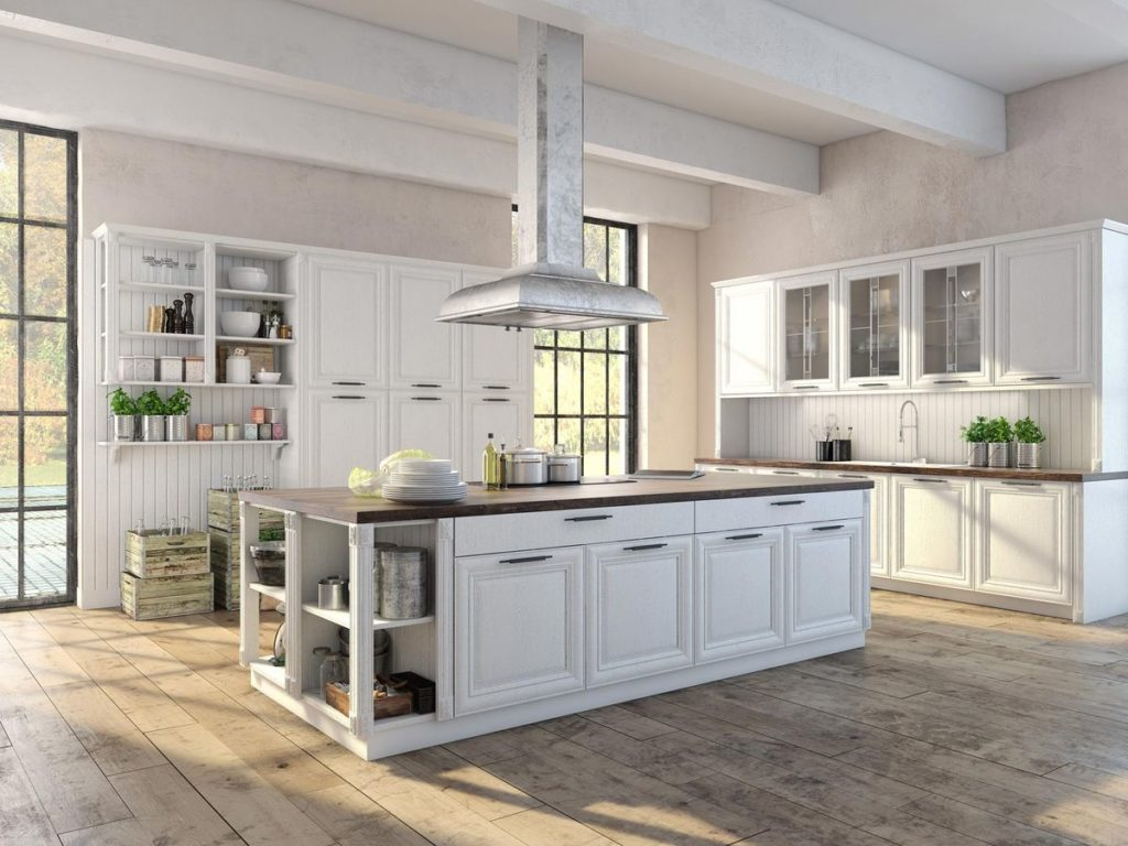 Modern farmhouse kitchen with butcher block island and white cabinets