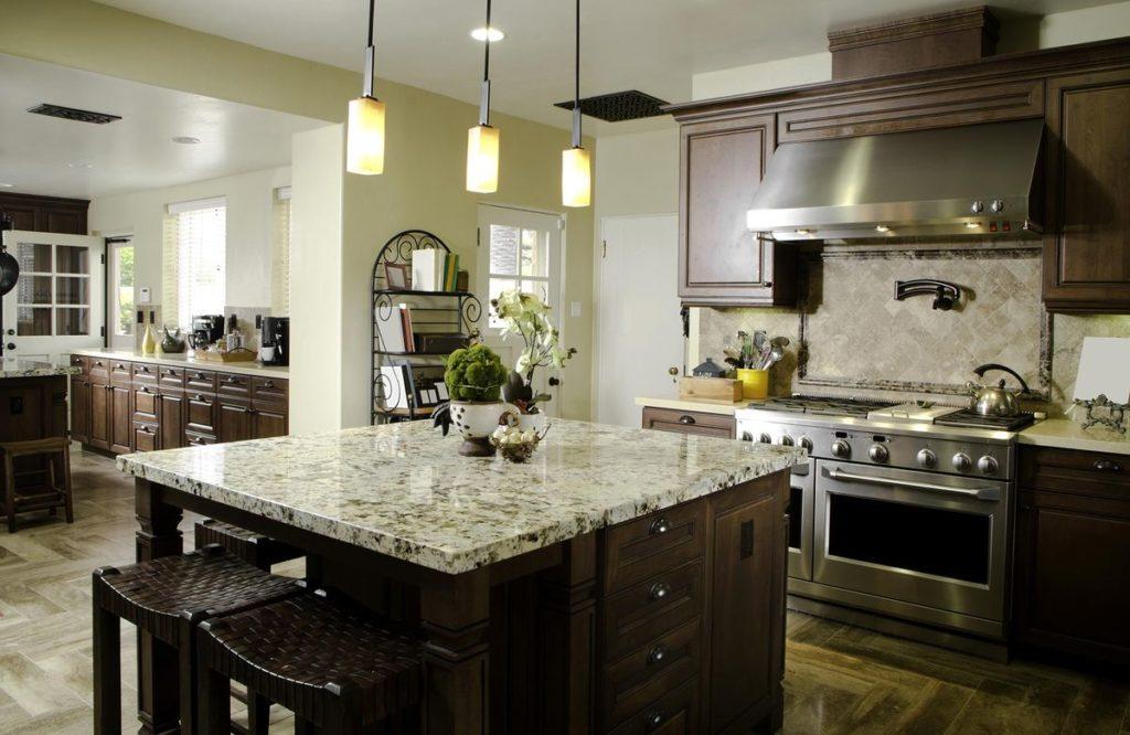 Dark wooden kitchen island with light granite countertop