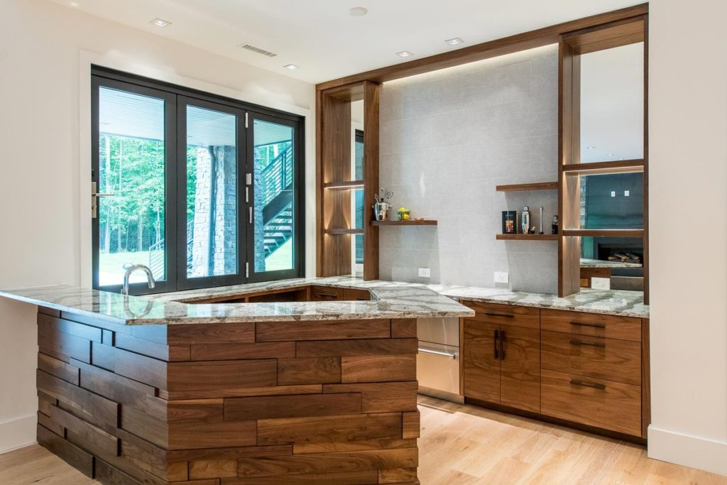 Mid-century modern kitchen with wooden cabinets, granite countertop and porcelain backsplash wall