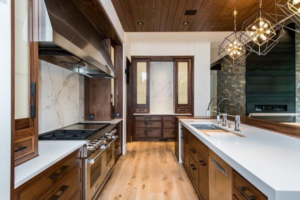 Modern wood kitchen with white Quartzite countertops with backsplash