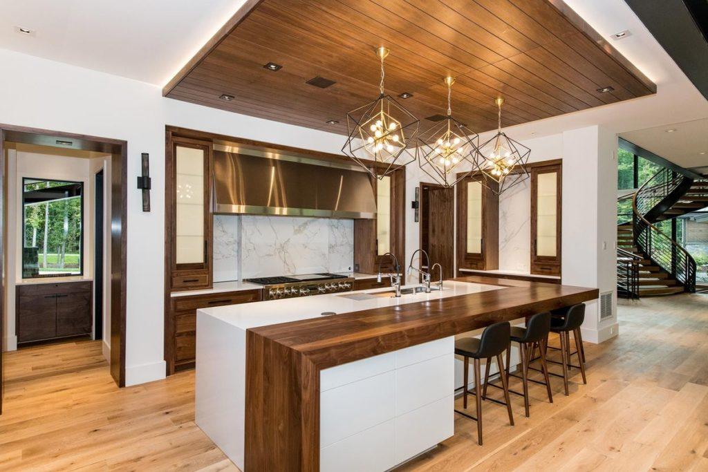 Modern kitchen island with split wood and quartz countertop
