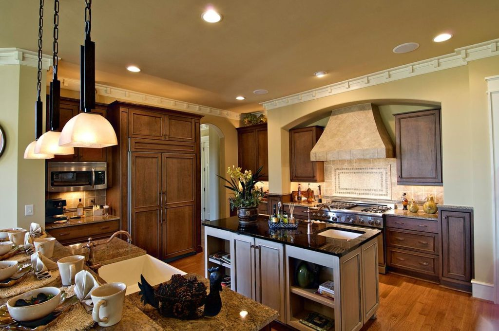 Traditional kitchen with granite countertops and island