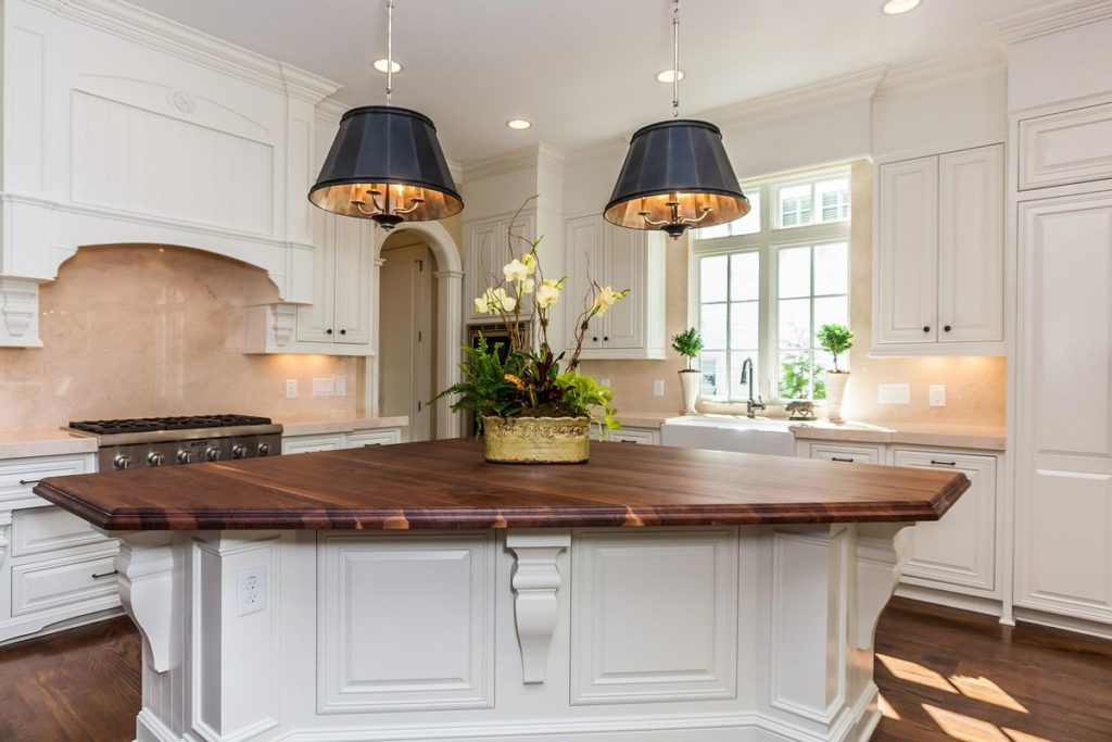 Traditional kitchen featuring triangular wood topped island