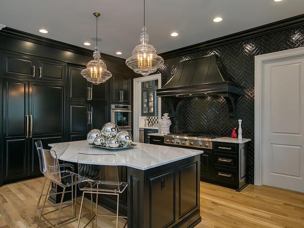 Black kitchen with black tile backsplash and contrasting kitchen island with quartz countertop
