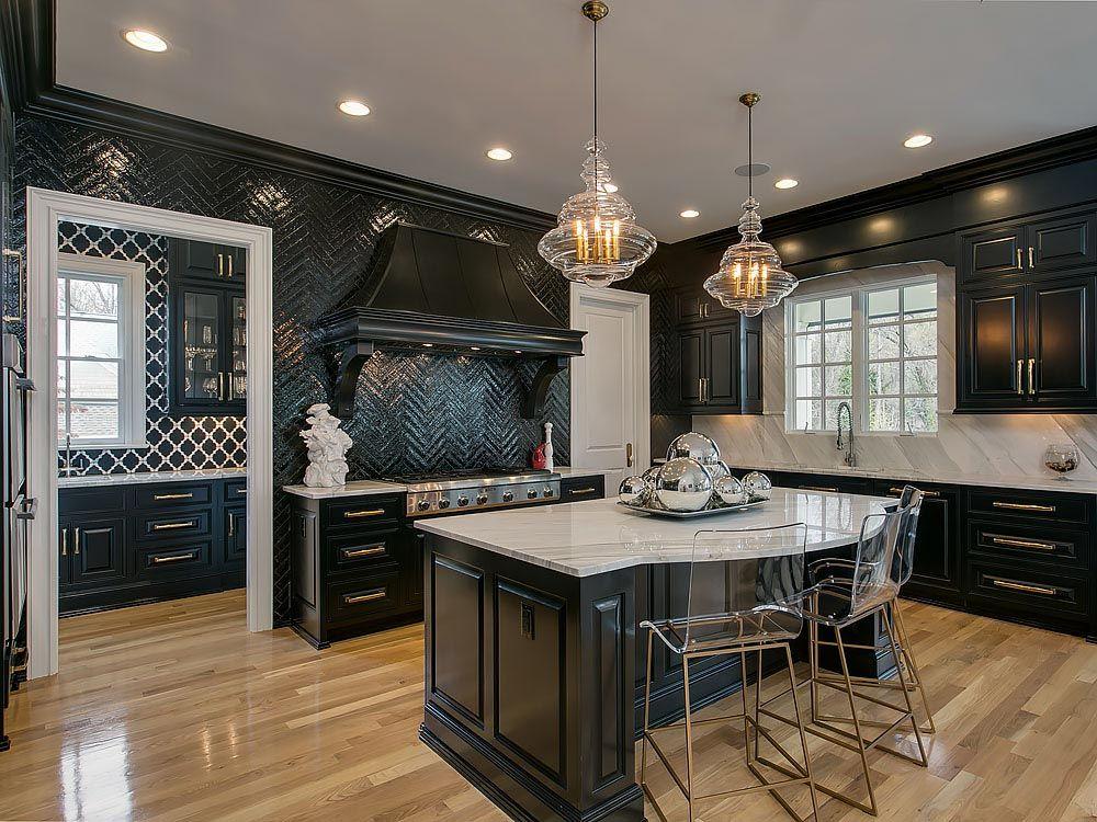 Black kitchen with black tile backsplash and contrasting quartz countertops