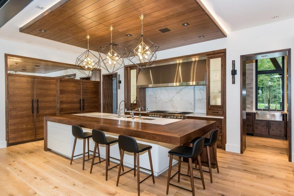 Stunning kitchen island with split wood and quartz countertop