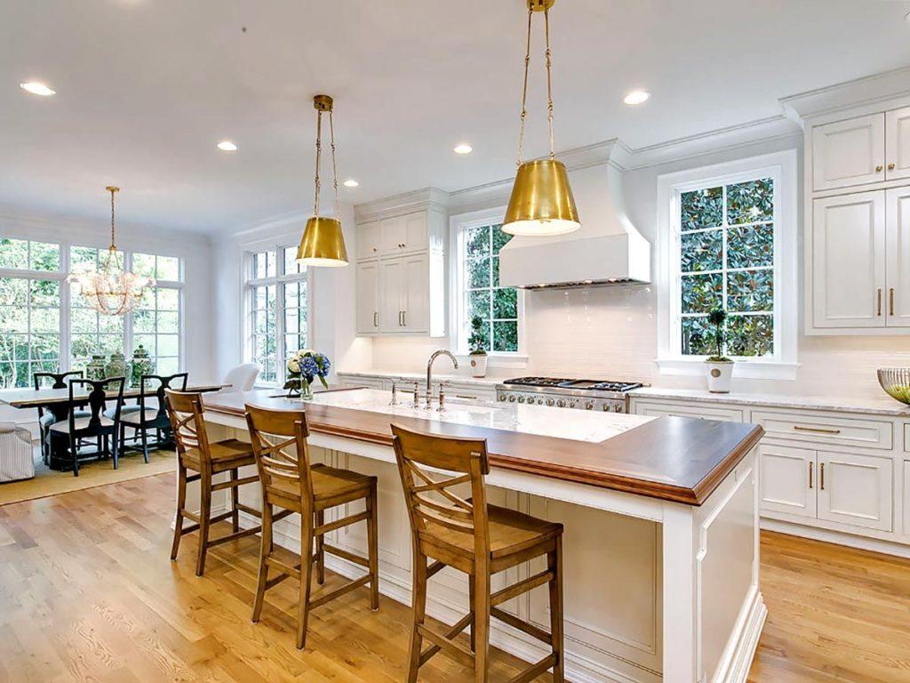 Kitchen island with split wood and quartz countertop