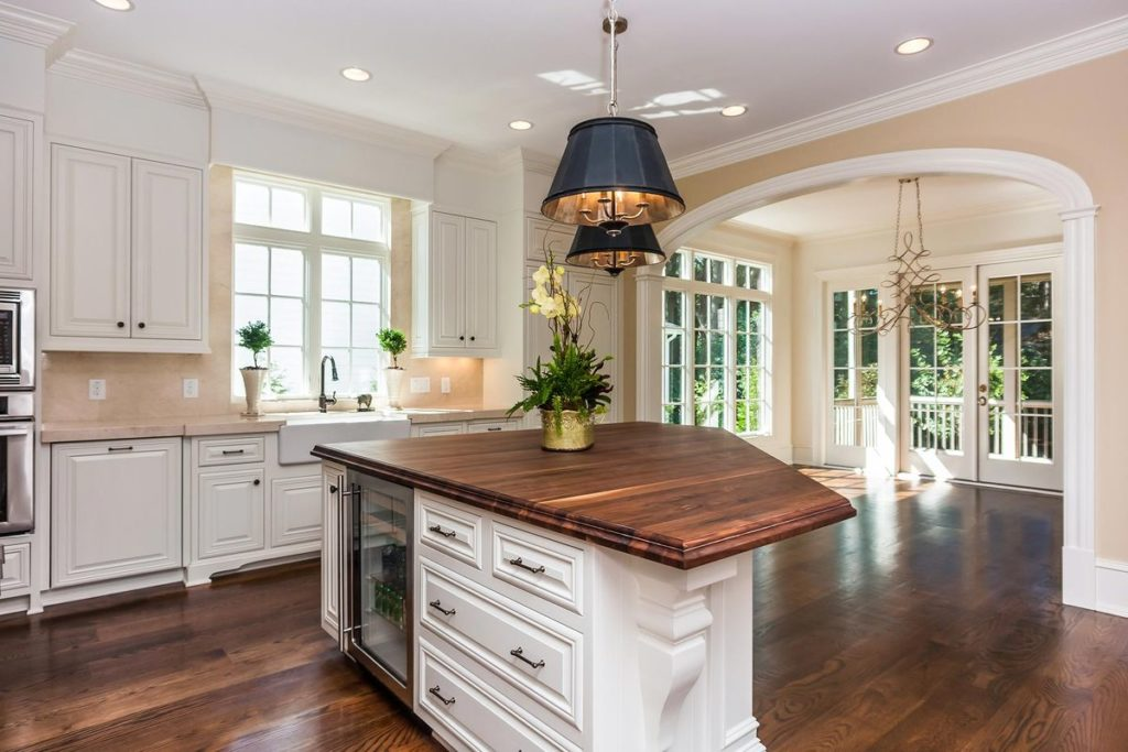 Stunning kitchen island with natural wood countertop