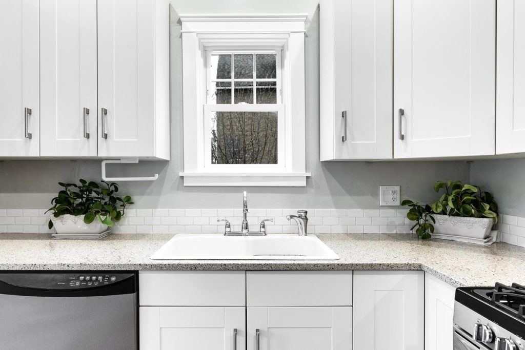 Kitchen with white shaker cabinets and granite countertops