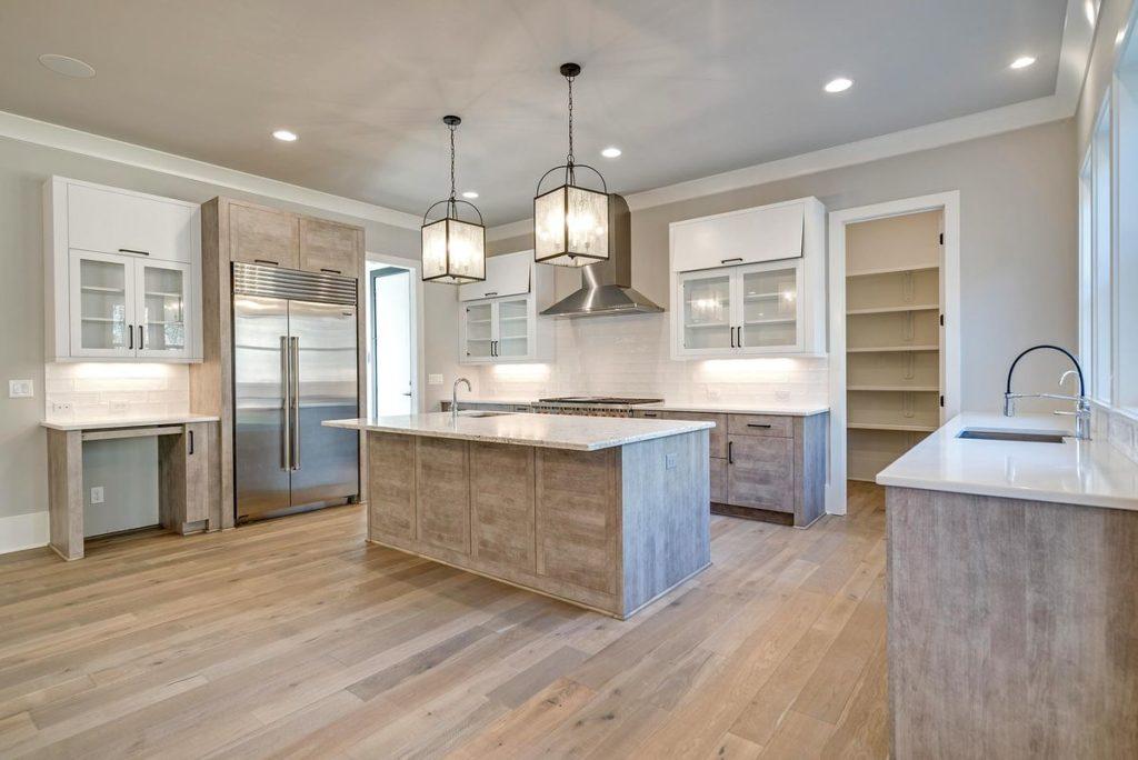 Minimalist kitchen with white quartz countertops and island