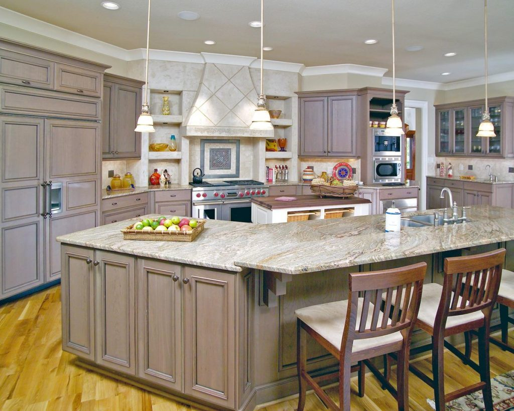 Kitchen featuring granite countertops and tiled backsplash and hood