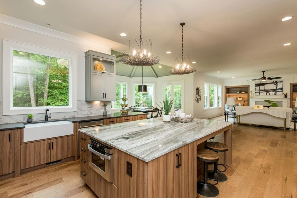 Modern kitchen with teak cabinets and stunning granite topped island