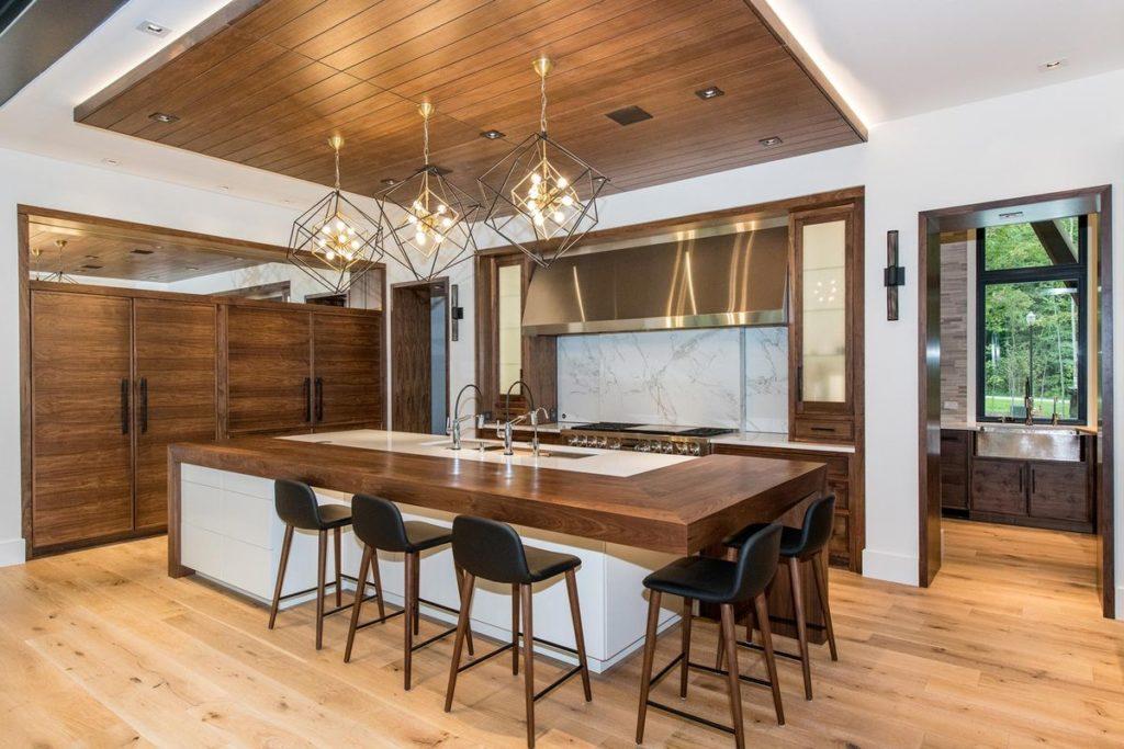 Mid-century modern kitchen with marble backsplash and teak and marble kitchen island