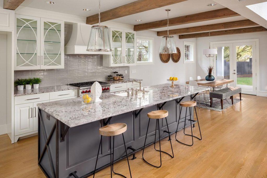 Sleek gray kitchen island with granite countertop
