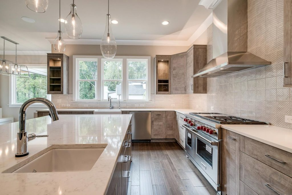 Modern kitchen with light gray cabinets and white quartzite countertops