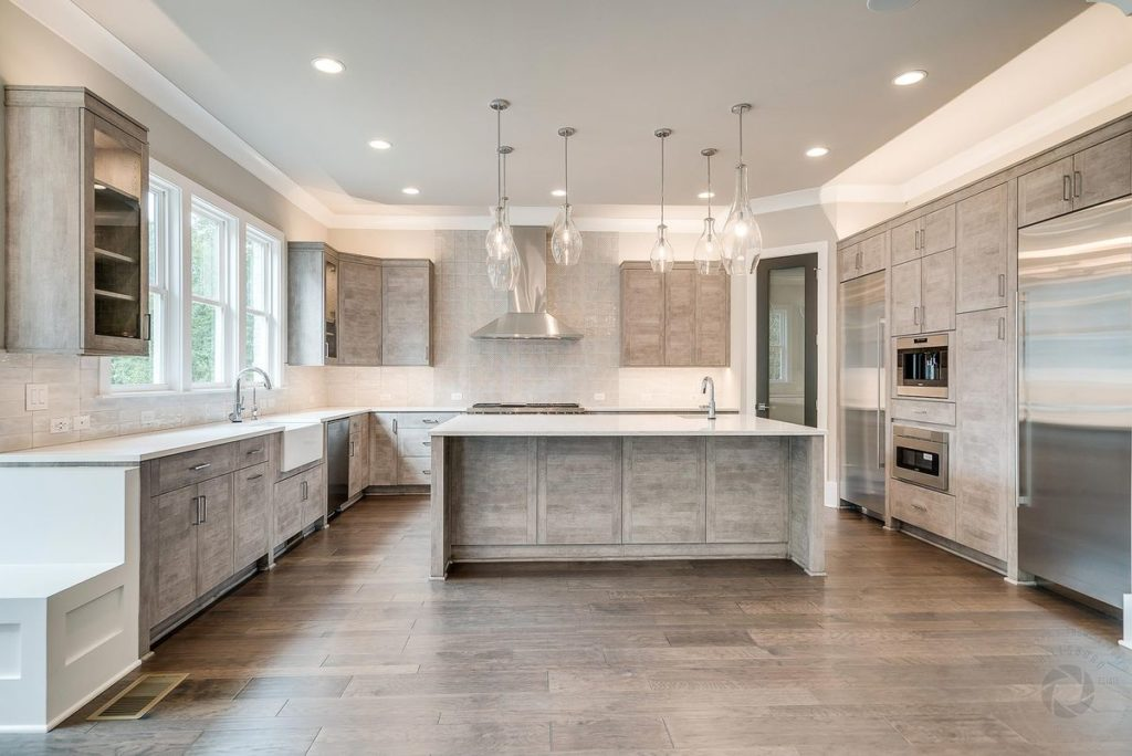 Modern kitchen with light gray cabinets and white quartzite island