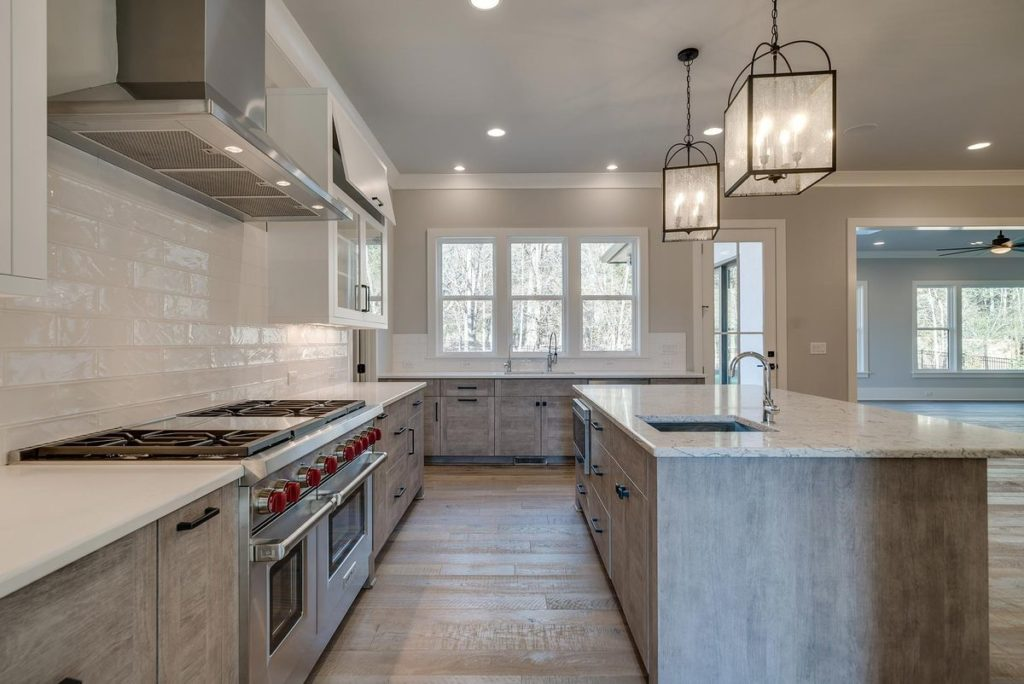 Open kitchen with granite topped kitchen island and white soapstone countertops