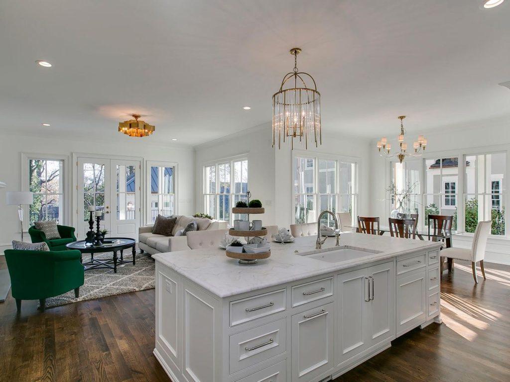 White kitchen cabinets and island with elegant white granite countertop