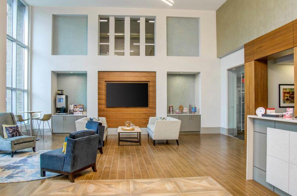 Apartment complex reception area with white quartz countertops and light gray cabinets
