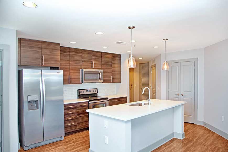 Modern apartment kitchen with built in sink kitchen island and white quartz countertop
