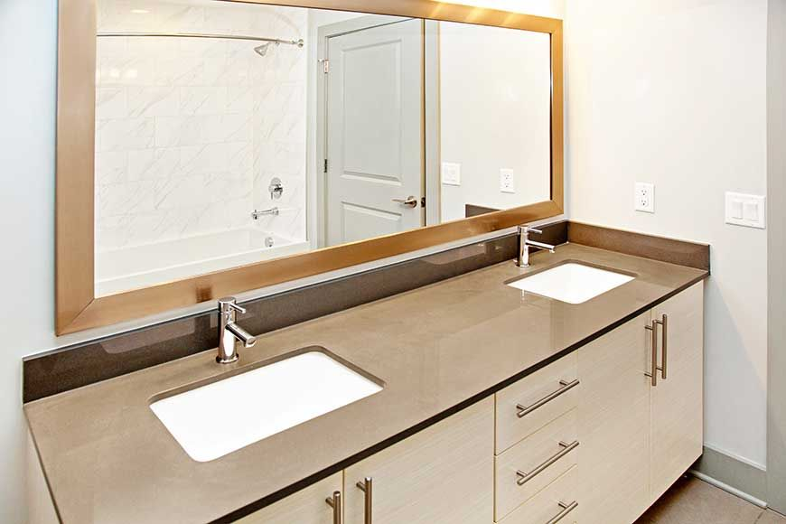 Modern white vanity with light gray soapstone countertop