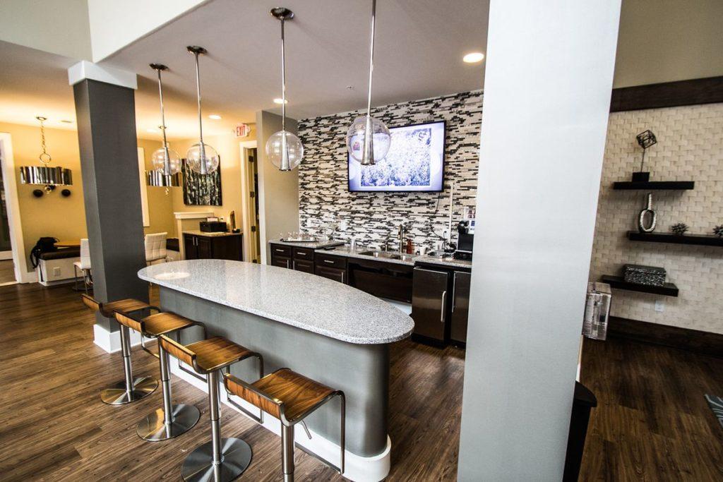 Modern apartment kitchen with half moon granite kitchen island