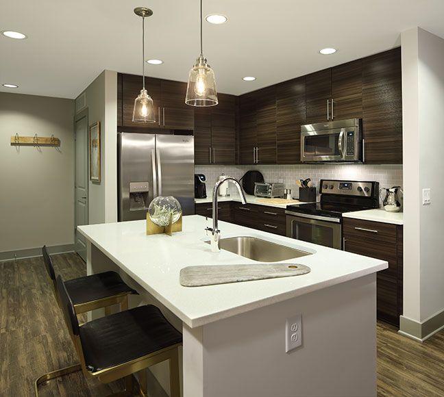 Apartment kitchen island with white quartz countertop
