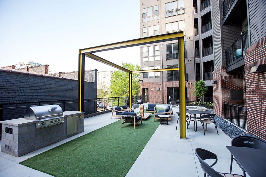 Apartment complex outdoor BBQ area with granite countertop