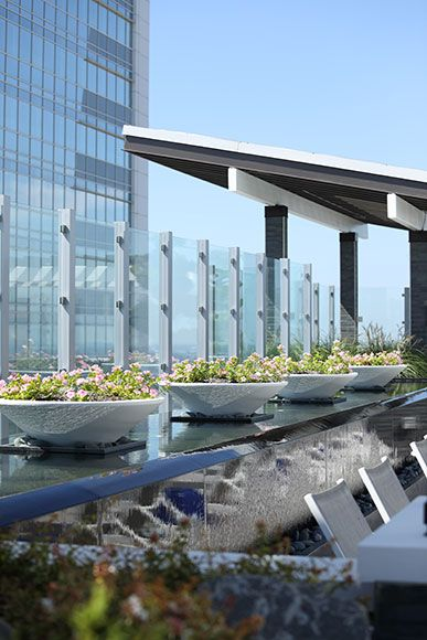 Apartment complex rooftop pool area with charcoal quartz water feature