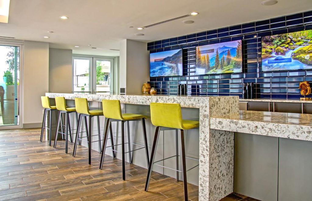 Large bar with granite counter and waterfall legs