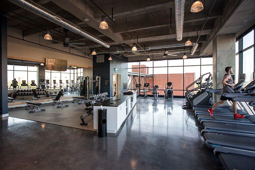 Apartment gym with dark soapstone utility counter