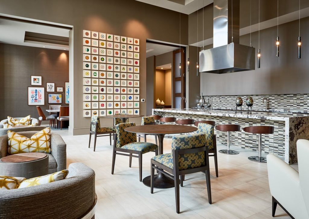 Apartment complex bar with large granite waterfall legged island