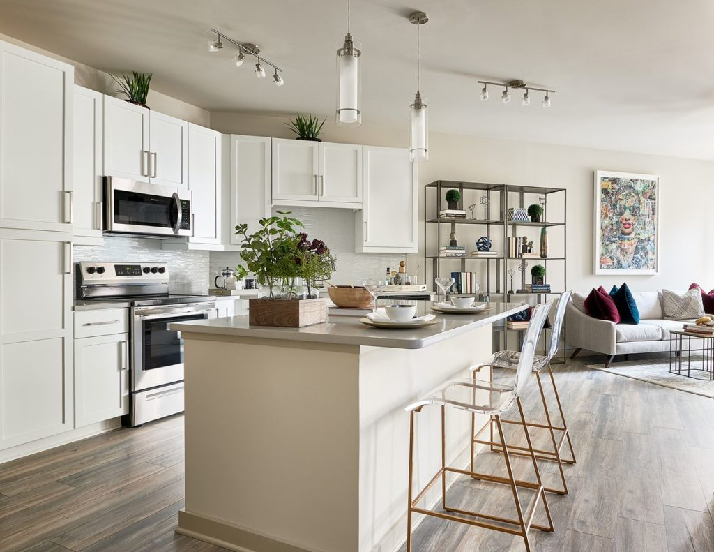 Modern kitchen with white shaker cabinets and light gray soapstone countertops